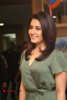 Actress Raashi Khanna Stills in Green Short Dress at Mirchi 95 Suno Aur Mercedes Jeeto Contest  0028