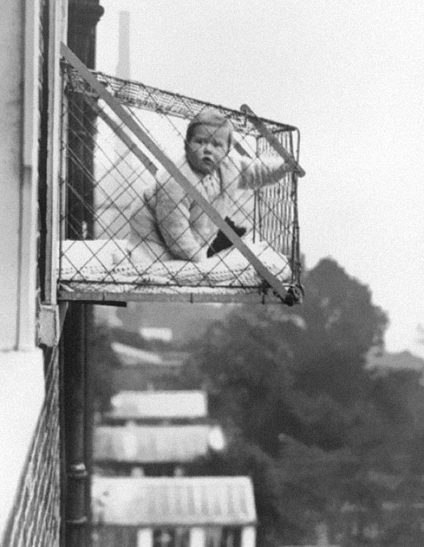 Baby cages used to ensure that children get enough sunlight and fresh air when living in an apartment building, ca. 1937-1