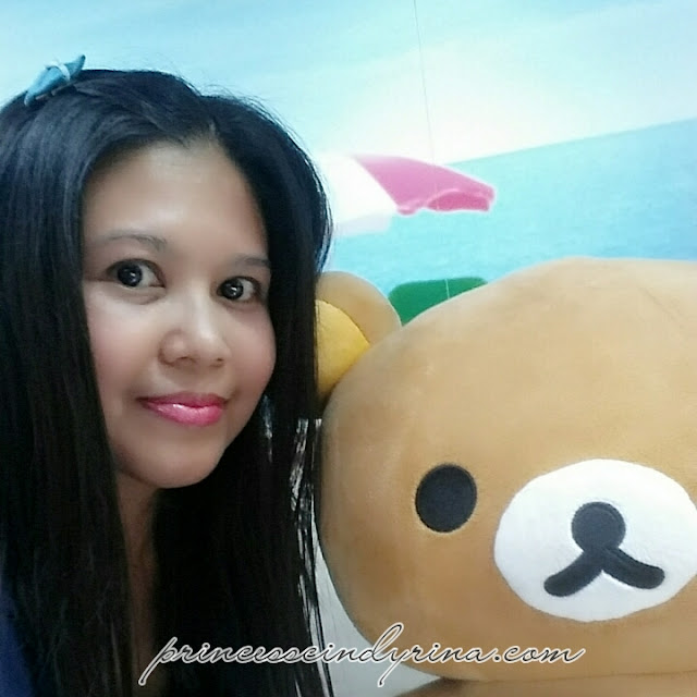 girl posing with Rilakkuma