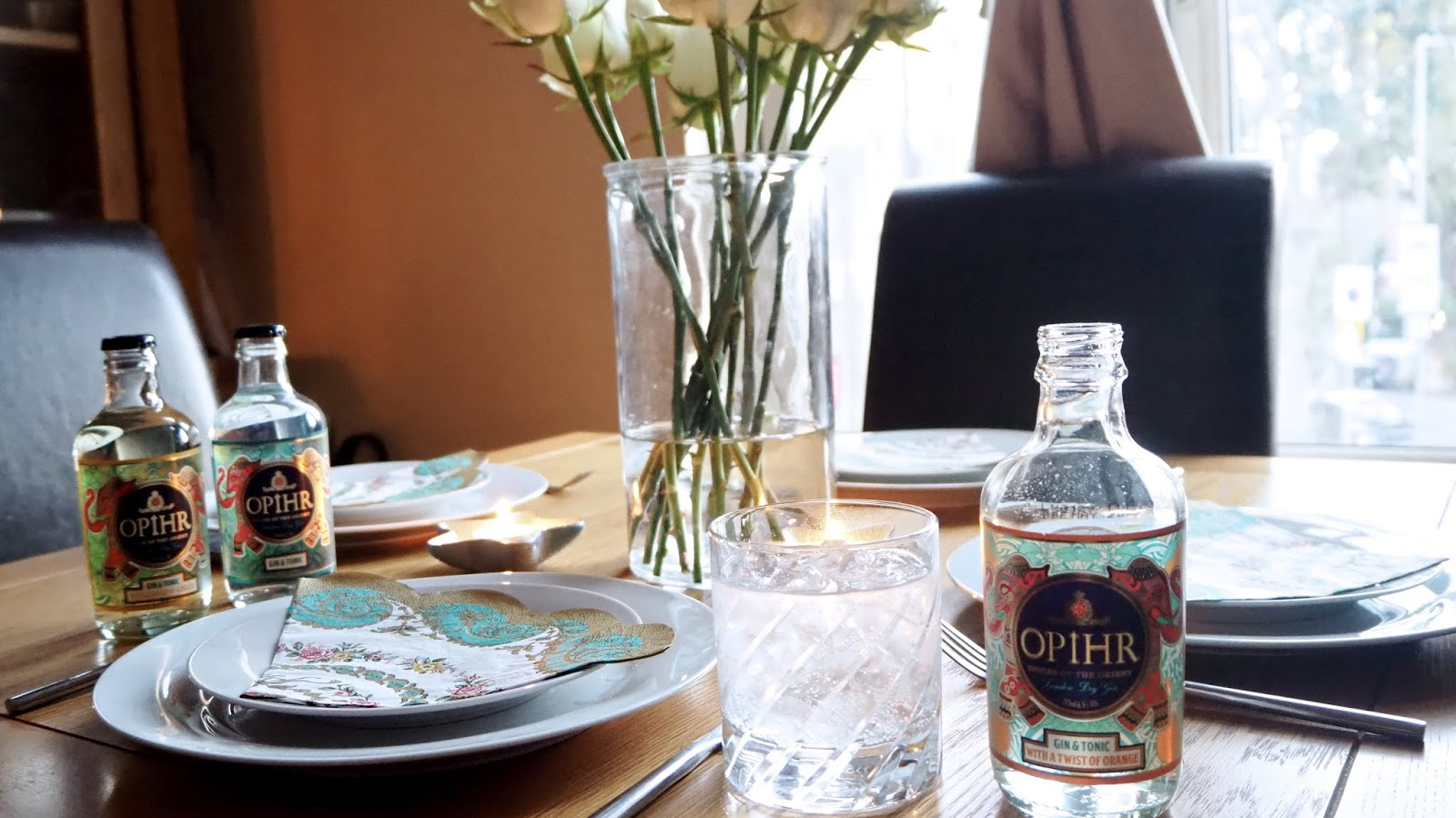 Tablesetting and bottles of Opihr Ready-to-Drink Gin & Tonic