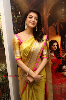 Actress Kajal Agarwal Stills in Golden Silk Saree at Trisha Sesigner Store Launch  0056.jpg