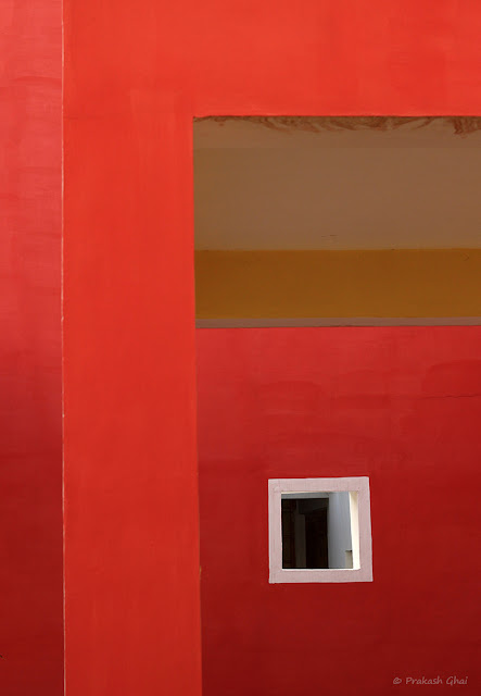 A Minimalist Photo of a White Square on a Red Wall