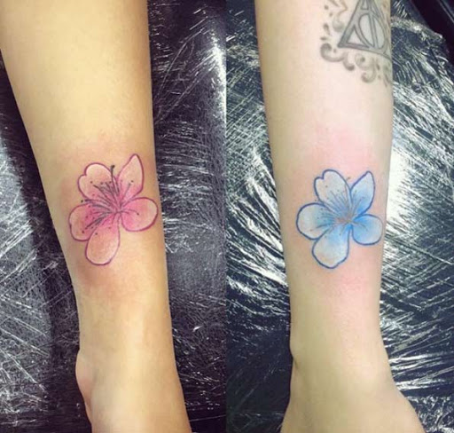 Estes florais irmã tatuagens