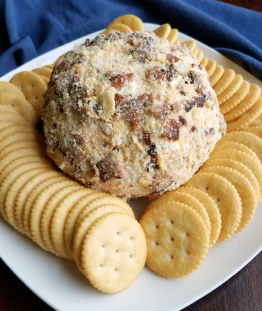 cheese ball coated in bits of bacon and cracker crumbs