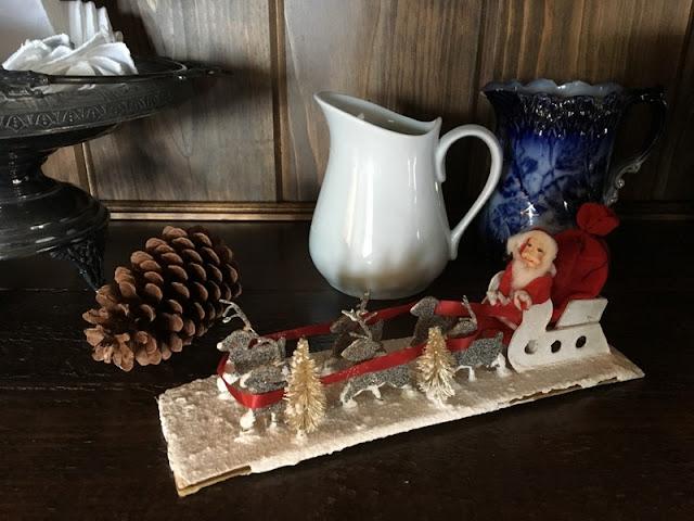 Santa in his sleigh Christmas ornament