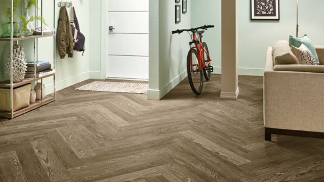 Chevron pattern hardwood-look plank luxury vinyl