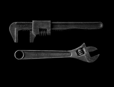 two wrenches in black and white
