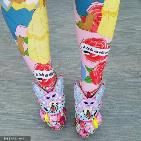 beauty and the beast themed tights worn with flowery shoes