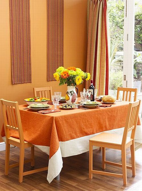 beautiful orange dining room with orange curtains, wall and chairs