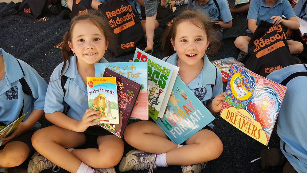 school kids opening gift of books