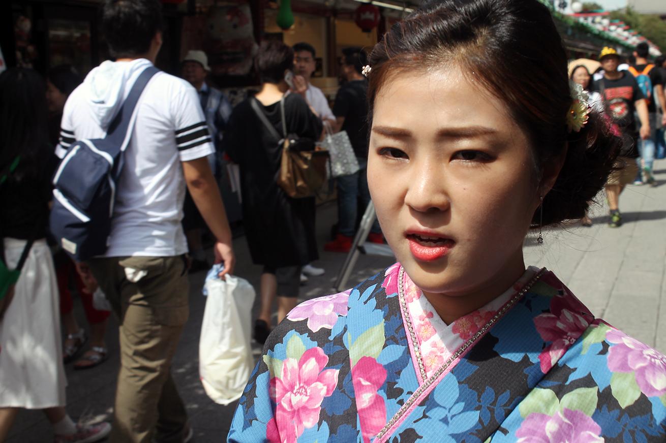 girl dressed as geisha in Tokyo