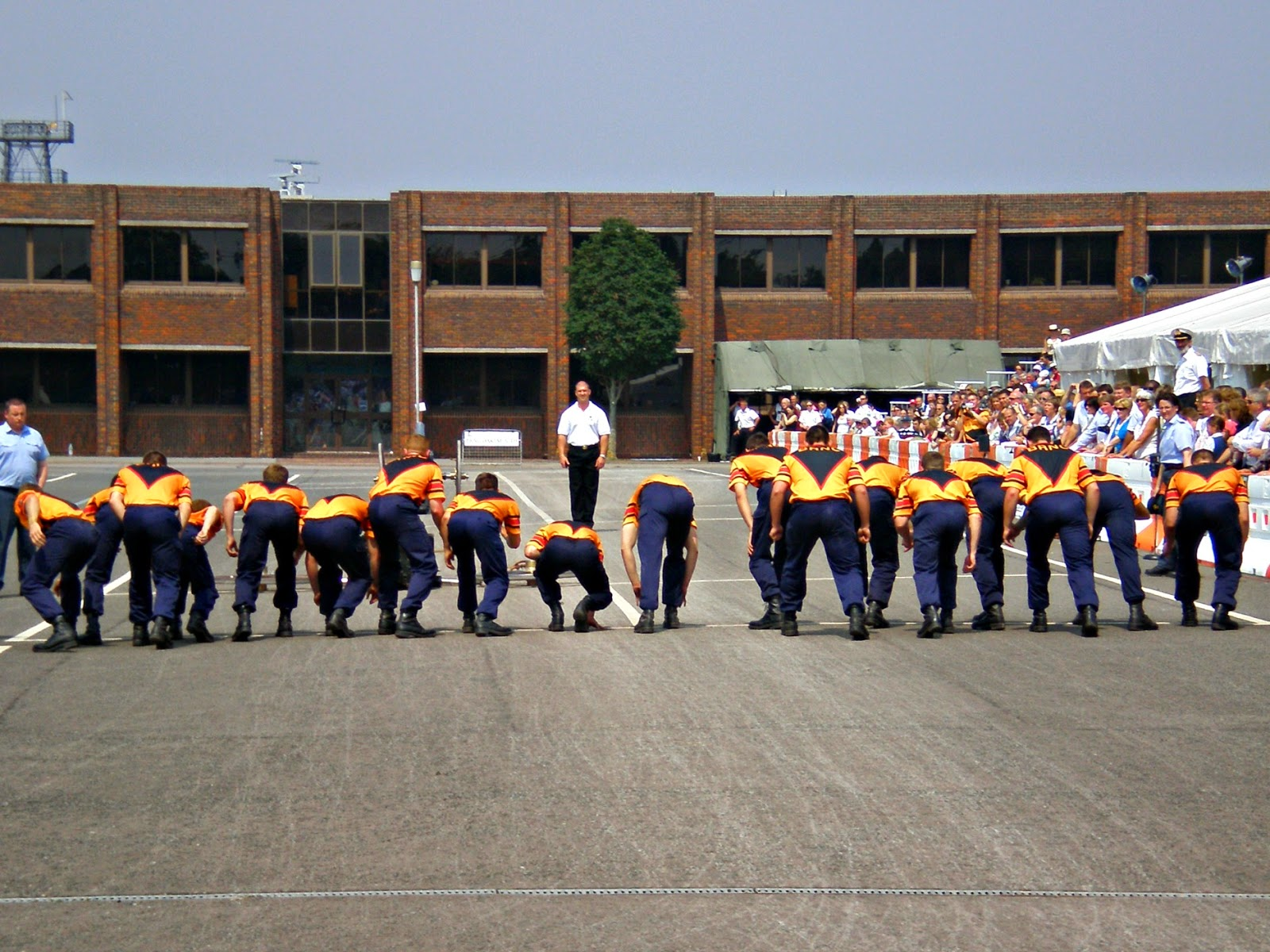 A crew of 18 field gunners line up on the start line