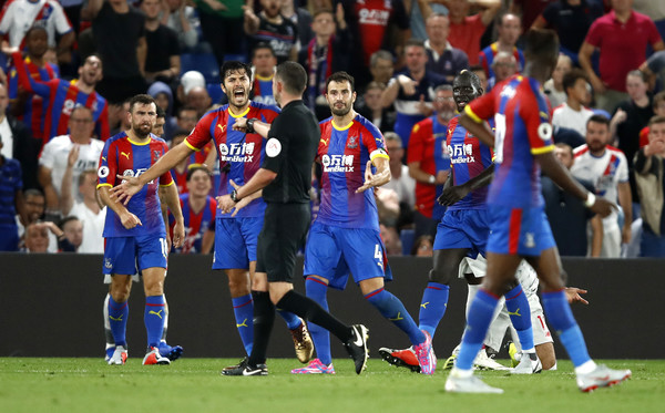 Crystal Palace players appeal to Match Referee, Michael Oliver during the Premier League match between Crystal Palace and Liverpool FC at Selhurst Park on August 20, 2018 in London, United Kingdom.
