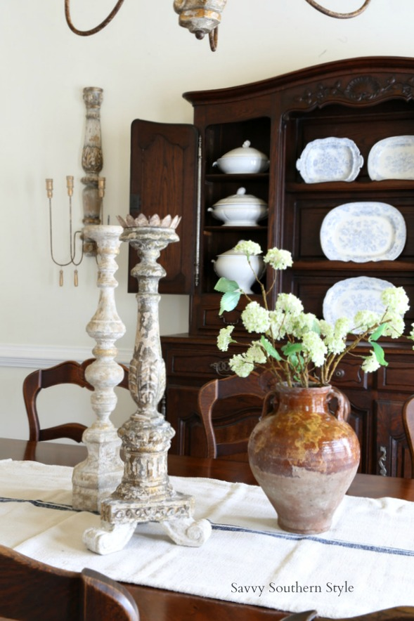French country style centerpiece using Aidan Gray candlesticks and antique pottery vase