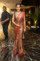 Tapsee Pannu Latest Stills in Red Silk Saree at Anando hma Pre Release Event .COM 0040.JPG