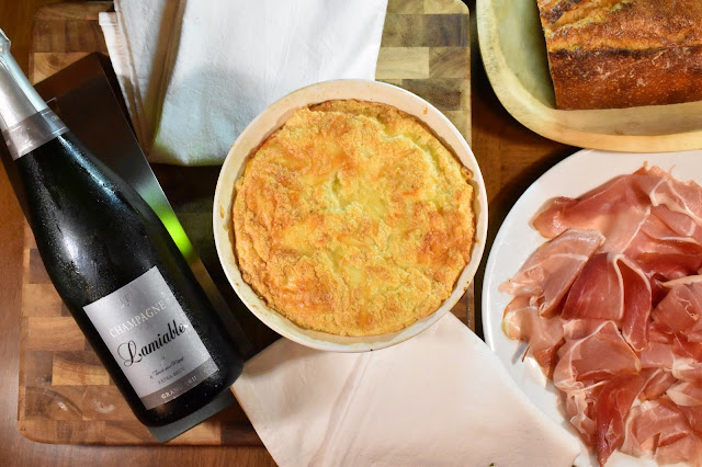 Champagne Lamiable Extra Brut with a Cheese Soufflé, prosciutto, and bread.