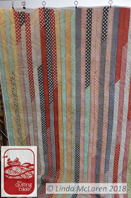 Long jelly roll race quilts