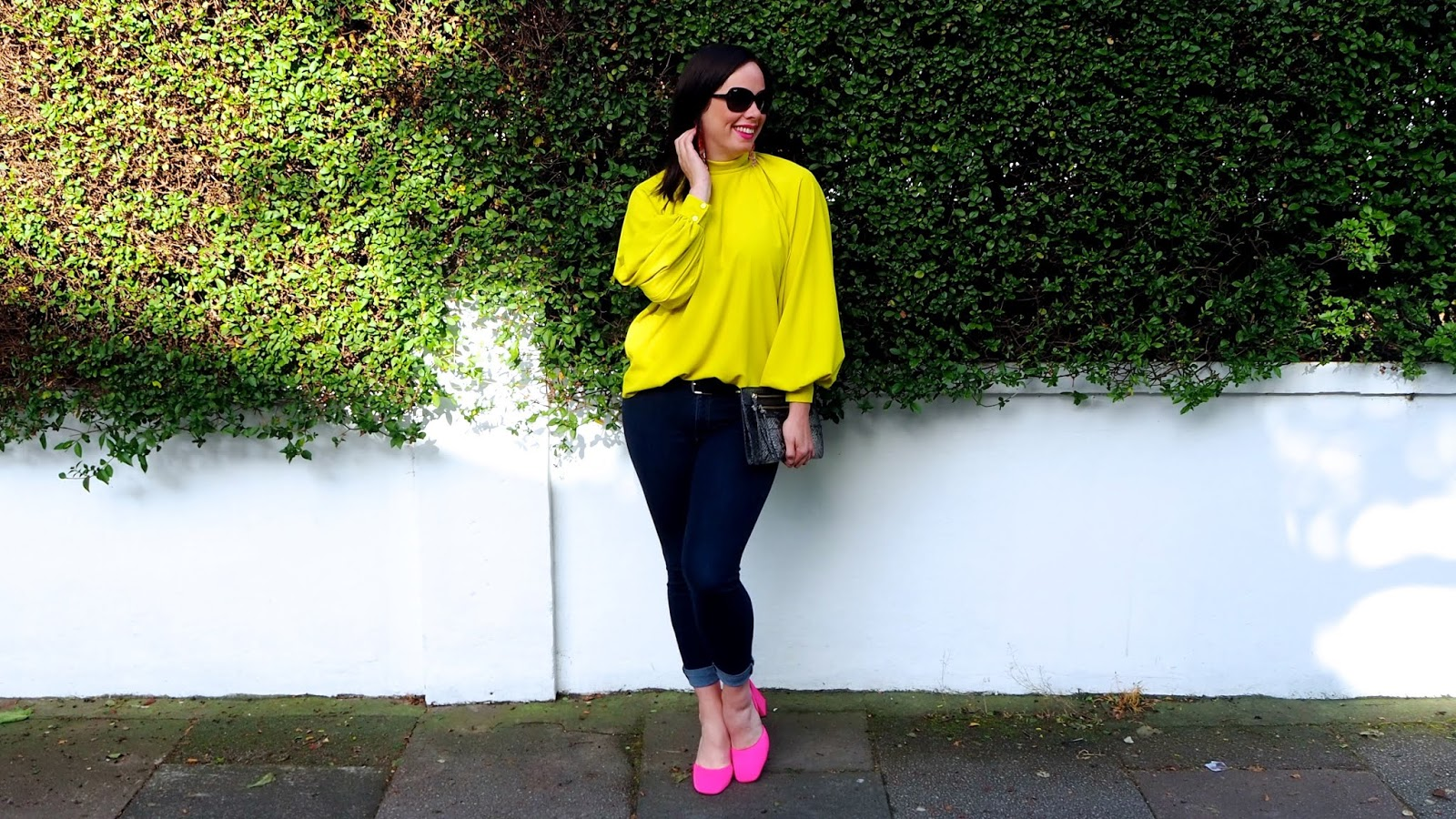 neon yellow high neck balloon sleeved blouse with neon pink slingback heels