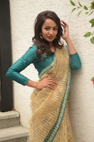 Tejaswi Madivada in Saree Photos at V Care Fundraiser Event TollywoodBlog