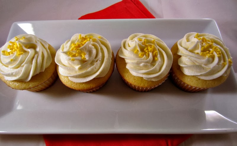 Renee's Kitchen Adventures:  Sweet Orange Cupcakes with Orange Butter Cream Frosting.  A light and moist cupcake bursting with orange flavor!  #cupcakes