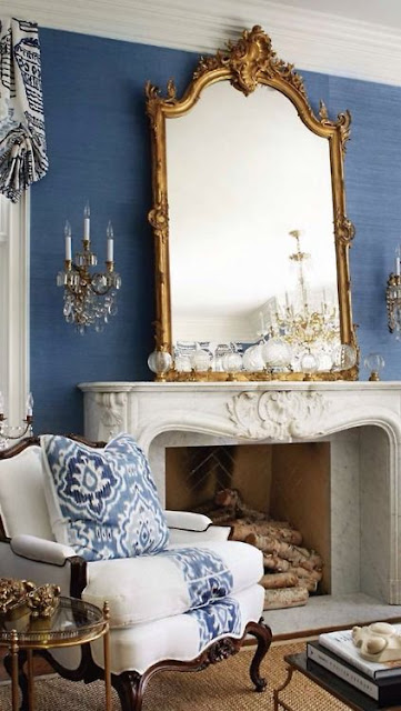 bergere chair blue and white fabric gold mirror fireplace