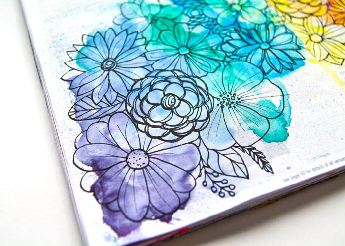 Close up detail of the watercolor rainbow and flower design. See how you can make one too in a the video by Kim Dellow