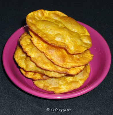Pumpkin poori in serving plate