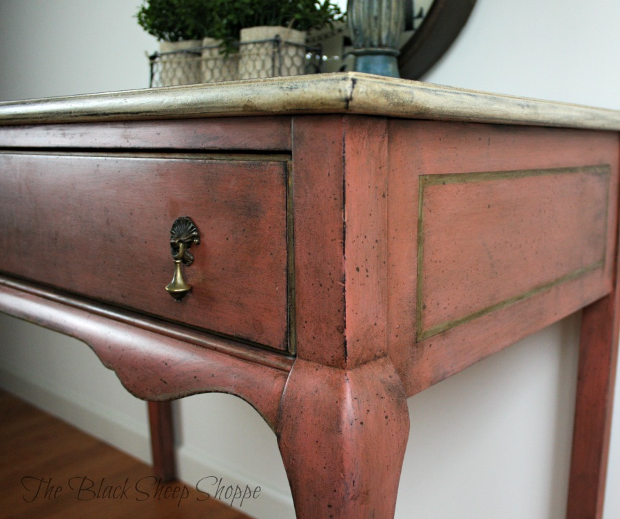 Corner of desk showing antiqued paint finish.