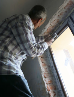 Removing the old damaged plaster