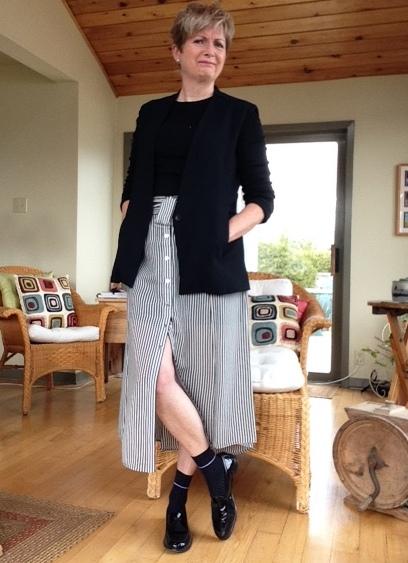 Black and white striped silk midi skirt from A.L.C., black Helmut Lang jacket, black Gap tee, black Stuart Weitzman loafers