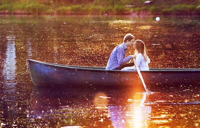 Romantic Love Couple Kissing on Boat Wallpaper