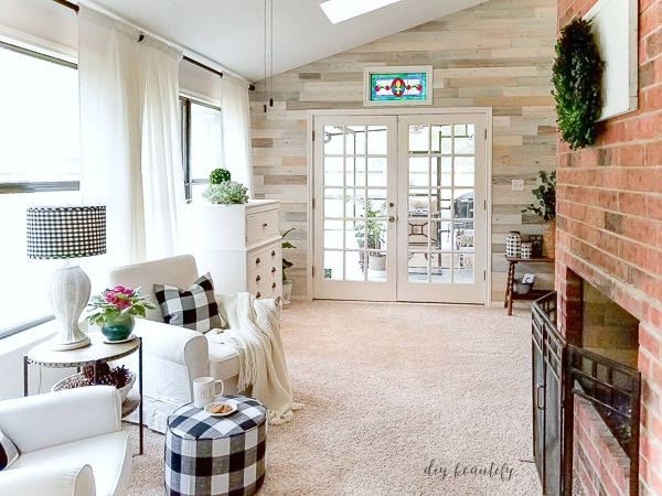 cozy sunroom with fireplace