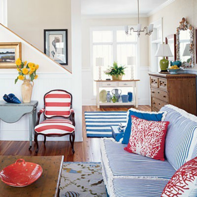 Coastal, nautical living room with navy, white and red
