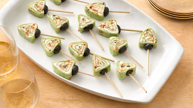 Enjoy this creamy appetizer made in creative tree shape Christmas Tree Roll-Ups Recipe