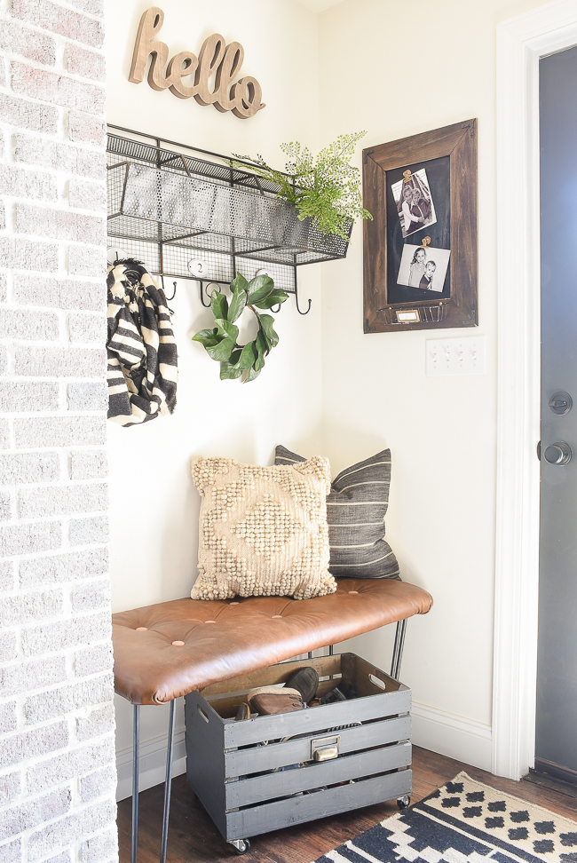 Modern farmhouse mudroom with Walmart Aztec Pillow
