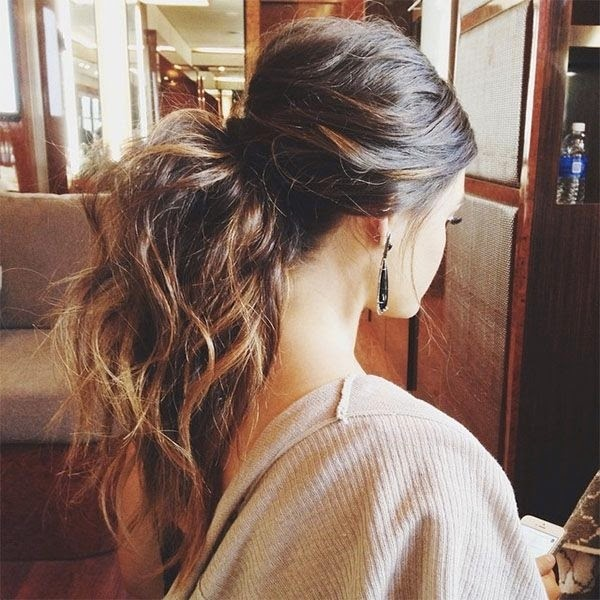 Big Messy Ponytail Hairstyle – Half up half down ponytail