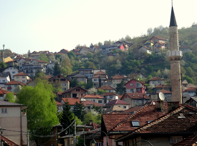Sarajevo sits in the bowl with a river stream flowing through it and surrounded by hills