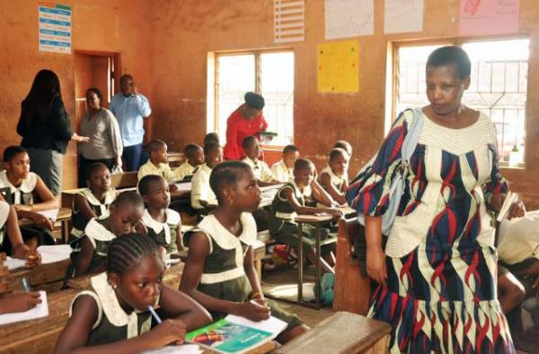 Deputy Director-General, Rwanda Education Board, Tusiime Angelique (right) during a visit to a primary school in Edo State to understudy the implementation of the Edo Basic Education Sector Tranformation (EDOBEST) programme, in Benin City.