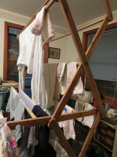 clothes drying on a wooden expanding rack