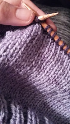 knitting a purple slouchy hat with Caron Cakes yarn