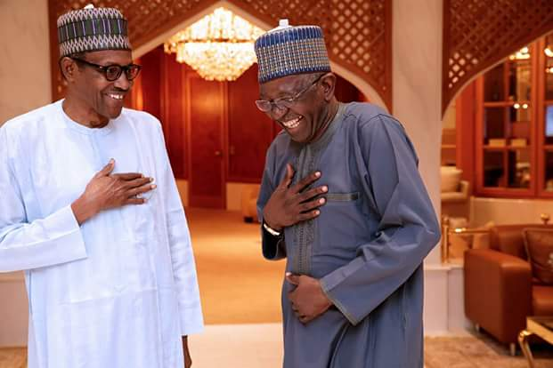 Photo: What did President Buhari tell this man that left him in splits?