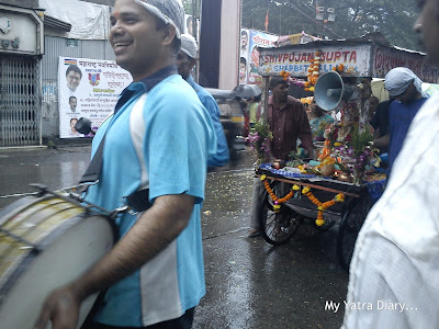 Beating of drums as Ganpati idols are taken for visarjan in carts