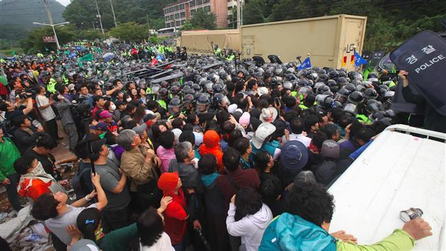 Police clash with protesters in South Korea as more THAAD launchers arrive