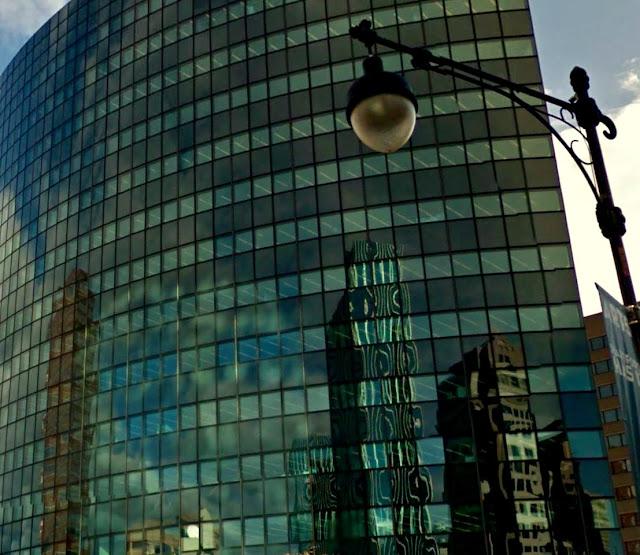 semi-circular glass-clad skyscraper reflects Hartford skyline
