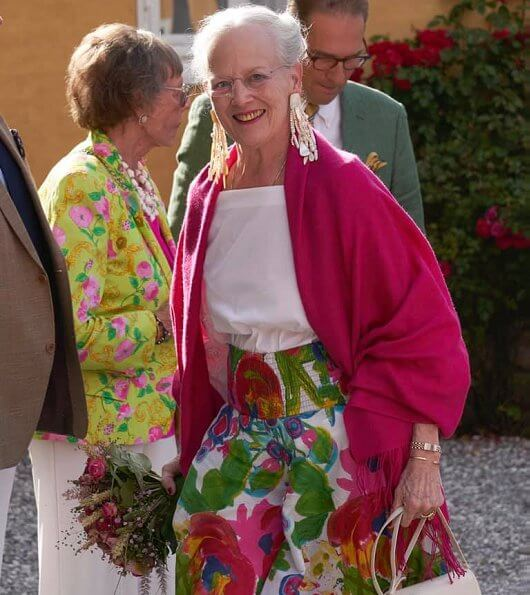 Queen Margrethe attended the World Ballet 2019 at Mollerup Estate. Queen's gold earrings and floral summer skirt
