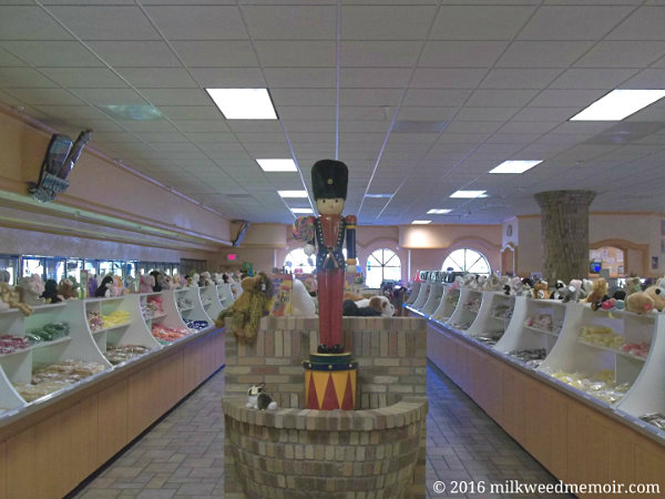 A nutcracker statue holds vigil over two huge rows of candy and nuts at the Death Valley Nut and Candy Co., part of Eddie World, a mega-stop in Beatty, Nevada
