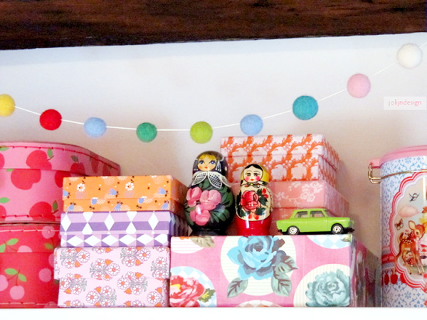 Covered paper boxes and pom pom garland