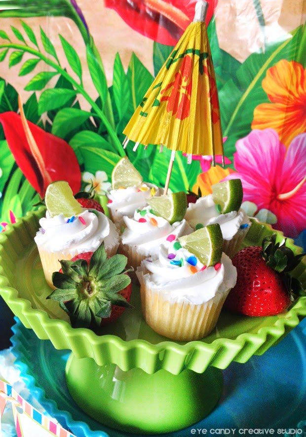 cake stand, mini lime cupcakes, tropical, drink umbrella, luau flowers
