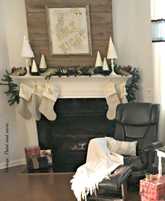 DIY drop cloth stockings, and small Christmas trees used on a Christmas mantel