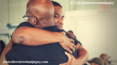 Two black men hugging